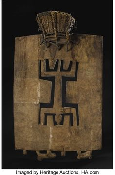 Senufo, (Ivory Coast) Ceremonial Headdress, kworo Wood on a basketry cap Height: 35 ½ inches Width: 22 ½ inches Such headdresses were worn in the kworo or second phase of Poro initiations among the Nafara Senufo, in which male and female initiates underwent death and rebirth along with arduous training...