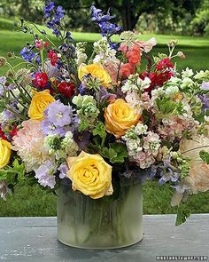 Summer Floral Arrangements-reminds me of grandmas service.