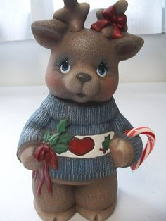 Ceramic Christmas reindeer girl holding holly leavescandy