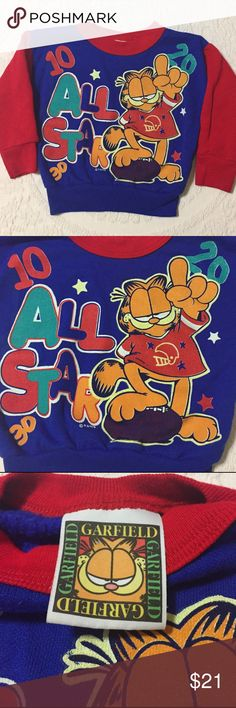 """Vintage '94 Garfield Baby Sweatshirt Very good condition for vintage. No cracking and not faded. There are stains on the left sleeve. See pic. Tag doesn't have a size. Looks like a 12 months but please go by measurements: pit to pit 12"""" length 12"""" includes bottom band. Sleeve from top of shoulder 10"""" Vintage Shirts & Tops Sweatshirts & Hoodies"""