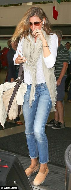 Chic touch: While embracing a predominately casual look that day, Gisele added an elegant ...