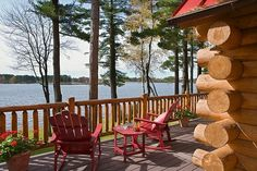 Interior and exterior images of Tomahawk log homes. Outdoor Spaces, Outdoor Chairs, Outdoor Living, Outdoor Decor, Adirondack Chairs, Summer Porch Decor, Cabin Decks, Vintage Cabin, Relaxing Places