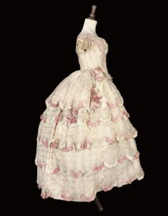 A BALL GOWN OF PINK AND WHITE CHALLIS, the transparent fabric woven with a pink and white stripe, and trimmed with sugar pink and white ruched ribbons, with deep pointed bodice and very full skirts Victorian Gown, Victorian Fashion, Vintage Fashion, Vintage Outfits, Vintage Gowns, Antique Clothing, Historical Clothing, Sheer Dress, Dress Up