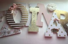 Pink and gold girls nursery letters, Blush and gold nursery letters - - - - ZOVINAR - - - -     {{ PRICE IS $20.00 PER LETTER}}   These gorgeous girls nursery letters are done in a pink blush, soft whites and a beautiful gold that looks simply stunning when the light hits it! The combination is the perfect mix of gold and pink! Adorned in luxurious embellishments, soft flowers, pearls and bows, they are sure to be the perfect addition to your little princess nursery!  To order these letters…