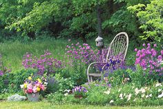 Rural cottage garden with quiet place for reflection in the shade at the edge of the woods, USA