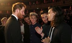 Britains Prince Harry greets members of One Direction after the Royal Variety Performance (em)