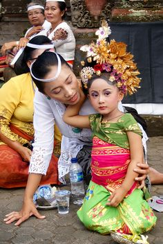 Tiny dancer at a temple ceremony, Bali, Indonesia. Children learn to dance from a very young age in Bali.