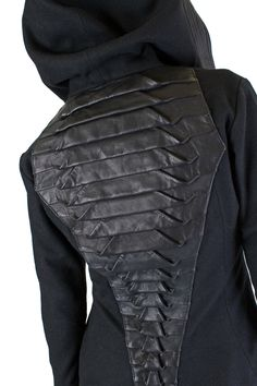 (VIEW 3 OF 3) Gelareh Crocodile Jacket – FIVE AND DIAMOND This jacket is so fashion forward that it's fashion future. Made of Galatic spun wool accented with leather rings around the waist and hood, the real eye-catcher is leather reptilian spine running down the back. Topping it out is an extra large collar to keep the harsh elements and solar radiation, at bay. LINK=>STORE; FOR SALE