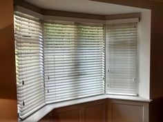 Wood venetian blinds for a bay window, supplied and installed by The Blind Shop.