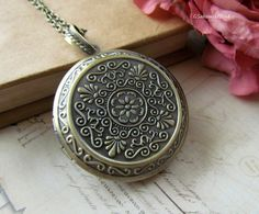 Antique Brass Large Round  Locket Necklace, Vintage Inspired  Long Chain Locket Necklace. $23.00, via Etsy.