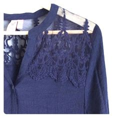 Lace and linen top Super cute!! Lace detail at top. Linen like fabric, 3/4 sleeve w button tie at sleeve. High low hem. Beautiful navy color. Excellent condition. Dolled Up Tops Button Down Shirts