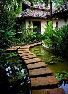 Beautiful stone path across a koi pond in a japanese garden Garden Paths, Garden Landscaping, Landscaping Ideas, Herb Garden, Garden Pond, Garden Bridge, Japanese Garden Backyard, Walkway Garden, Balinese Garden