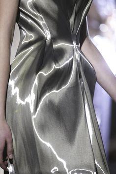 Sleek Metallic Fluidity - silver dress using tactile, glossy fabric; futuristic space age fashion details // Iris van Herpen