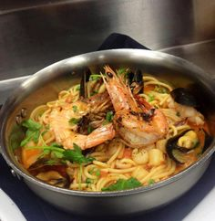 Seafood Spaghetti with bay scallops, squid, mussels & prawns and served in a saffron roasted tomato sauce!