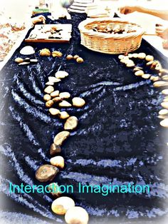 "Crushed velvet on the table with baskets of stones, chestnuts & shells - & more!! - from Interaction Imagination ("",)"
