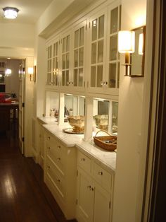 butler's pantry between kitchen and dining room - only imagine with a wood counter stained very dark