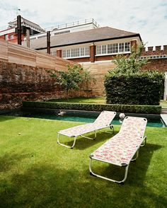 Cath Kidston - A pair of floral chaises beside a rectangular pool