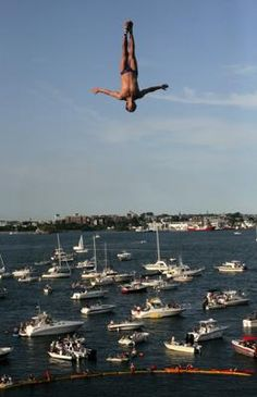 With thousands of people gathered at Fan Pier and Boston Harbor, a diver jumped from the platform built onto the Institute of Contemporary Art during the second annual Red Bull Cliff Diving World Series. photo: Tamir Kalifa for The Boston Globe