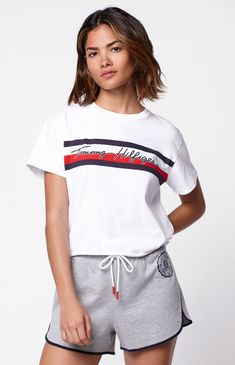 Tommy Hilfiger adds to your tee collection with the Cropped Flag T-Shirt. This not-so-basic tee features short sleeves, crew neckline, graphic at the chest, and a cropped fit. Athleisure Outfits, Sporty Outfits, Casual Outfits Summer Classy, Tommy Hilfiger Outfit, Blazer Fashion, Women's Fashion, Pajamas Women, T Shirts For Women, Pacsun