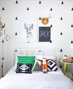 I love black and white as a background for kids rooms, so much colour comes from all their toys, books and accessories...