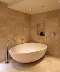 Limestone bathroom with egg bath - Definitive Interior Design