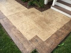 Stamped concrete patio with simulated wood plank boarders by Sierra Concrete Arts.