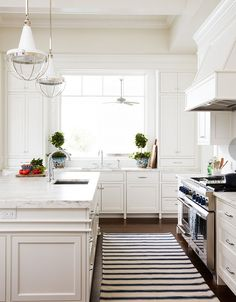 """Love these pendants by Urban Electric. Cabinet paint color is """"Benjamin Moore OC-17 - good off-white paint color for cabinets especially if you have darker hardwood floors."""