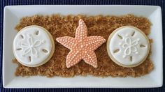 These starfish and sand dollar cookies were so much fun to create and would be perfect for a wedding with neutral colors or just as a s...