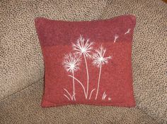 Fulled pillow with needle felted design