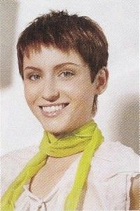 Very Short Cute Pixie Haircuts Model has Thick Hair which adds  Texture to this Cute Pixie.  Uneven Choppy Layers are cut through-out the interior.  This Sassy Very Short Pixie Haircut is easy to Maintain and Style.