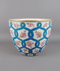A Sevres Style Jardiniere, of circular form, decorated with floral sprays separated by scrolling and intertwining lines.