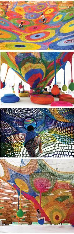 This playground is hand knitt by Toshiko Horiuchi Macadam. Designed for children to crawl, swing, and climb!