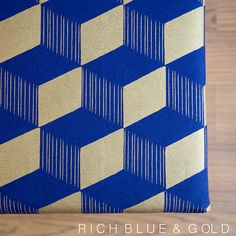 Hand screen printed navy linen fabric with gold geometric cube pattern to sit on top of my ottomans