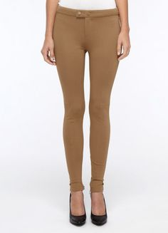 A touch of equestrian chic makes these slim legging pants an ultra-stylish option, with snap detailing at the tab waist closure and flattering vertical seaming.