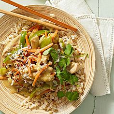 Thai Green Curry Chicken: Top brown rice with carrots, chicken, and sweet peppers to create an Asian-inspired dinner everyone will love. Mild coconut milk adds a bit of sweetness, countering the heat from the classic Thai flavors found in this healthy chicken stir-fry.
