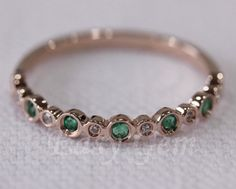 I've thought about mixing metals, so if we went with Emeralds, I LOVE the Rose Gold setting! Makes the Emeralds pop.  Natural Emerald Wedding Ring/Anniversary Eternity Ring with Diamonds,14K Rose Gold/Emerald Ring/sapphire ring/Anniversary Ring/Emerald Band