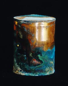 """For over twenty years the Oregon State Psychiatric Hospital stored the cremated remains of patients in copper containers. Photographer David Maisel found them, and shows the beautiful — and bizarre — chemical reactions that took place as the canisters corroded in his exhibit """"Library of Dust."""""""