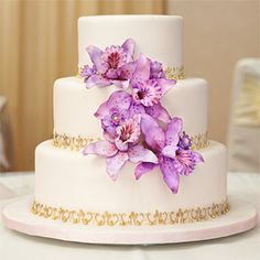 Flour Power Thailand in Toronto was the theme for this sweet floral cake. When conflicting schedules forced a couple to move their destination wedding from Asia to Canada, the pair reflected their original Thai inspiration with the gold scroll work and deep purple hues of the orchids of this three tier cake. I Do! Wedding Cakes, idoweddingscakes.ca.