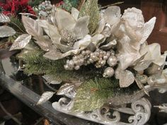 Fab table or mantle Centerpiece. Glittered Sleigh with beautiful white poinsettias and a trumpeting fat cherub $60