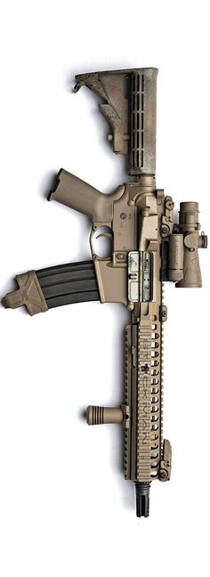 Stick's FDE SBR with Browe optic. The furniture is Magpul, the VFG is from Gear Sector, the mount is from AAC.