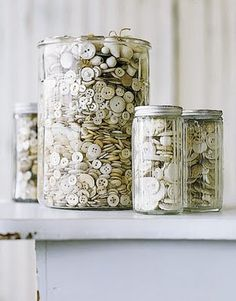 Using glass pots to organize vintage buttons and things.