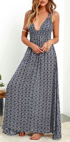 This sun-ready maxi starts with dual tying spaghetti straps that top a plunging V front, plus deep arm openings and a smocked waist. The woven navy blue and ivory print fabric cascades into an elegant maxi skirt for a positively breezy look. #lovelulus