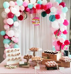 Baby shower dessert table with donuts, macaroons and pink and teal balloon arch // Beautiful beyond weddings party inspiration {Facebook and Instagram: The Wedding Scoop}