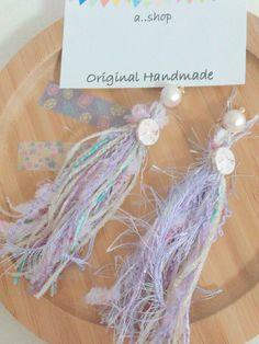 沢山の作品の中からご覧いただきありがとうございます♡もこもこのおしゃれ糸とリボンがデザインされたボタンをアクセントに付けております。コットンパールでさらに可愛さUP!可愛い物が好きな方にオススメです♡- - - - - - - -◆ハンドメイド作品の為、...