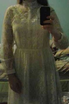This white lace simplistic dress is what cecily would wear. Something that represents the country living and modern fashion. The dress has long sleeves all the way down the arm and a turtle neck. It goes all the way down to the ankles. since this time was so conservative, covering as much as the body was a must.