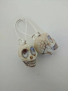 Check out this item in my Etsy shop https://www.etsy.com/listing/528603881/stone-skull-dangle-earrings-with-chrome