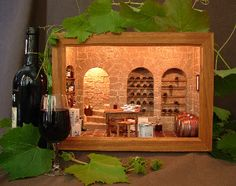 I made this wine cellar vignette for my husband's birthday in March He is a winemaker, so I tried to use his own wine labels as far as possible, but also from other wineries here in the Western. Vitrine Miniature, Miniature Rooms, Bar Scene, Ribba Frame, Altered Boxes, Mini Things, Miniture Things, Planter Boxes, Dollhouse Miniatures