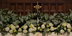 WHITE CALADIUM PLANTS BANKED ON ALTER AT DAUPHINWAY METHODIST CHURCH,MOBILE, ALABAMA