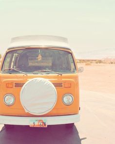 This photo is simply dreamy. Makes me wish for some wanderlust sort of afternoons. :: Orange Volkswagen van by diemdesign