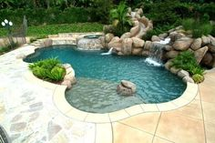 Love this pool!!! Kidney shaped....check, Attached hot tub...check, Rock wall with Waterfall...check